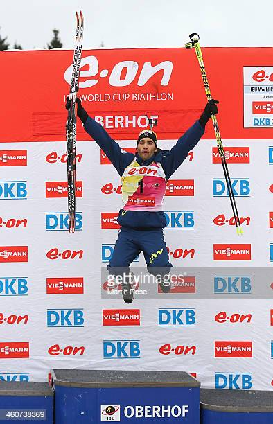 Martin Fourcade of France celebrates after winning the men's 15km mass start during the IBU Biathlon World Cup on January 5, 2014 in Oberhof, Germany.