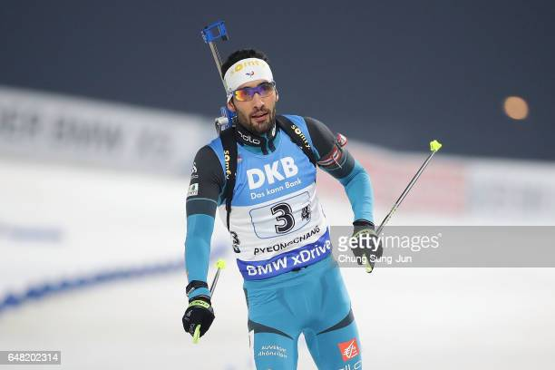 Martin Fourcade of France celebrates after winning the Men's 4x75 Km Relay during the BMW IBU World Cup Biathlon 2017 test event for PyeongChang 2018...