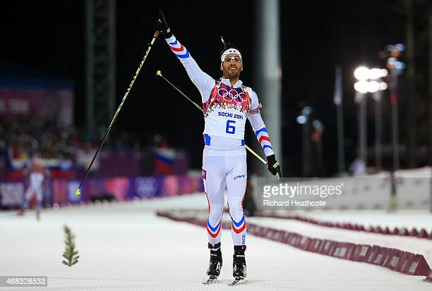 Martin Fourcade of France celebrates as he approaches the finish line to win the Men's 12.5 km Pursuit during day three of the Sochi 2014 Winter...