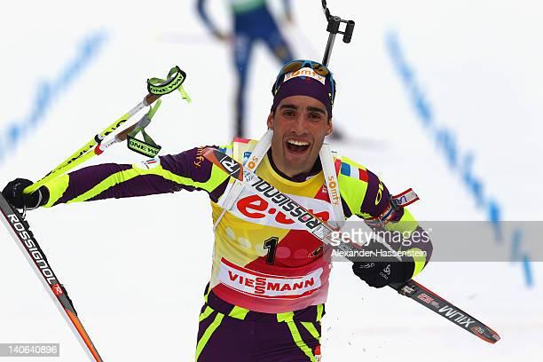 Martin Fourcade of France celebrates at the finish line winning the Men's 12,5km Pursuit during the IBU Biathlon World Championships at Chiemgau...