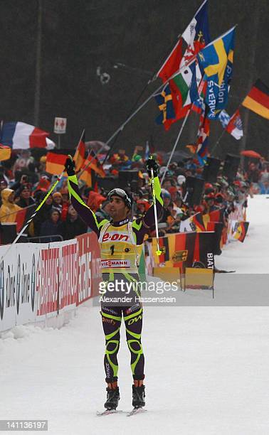 Martin Fourcade of France celebrates at the finish line winning the Men's 15km Mass Start during the IBU Biathlon World Championships at Chiemgau...