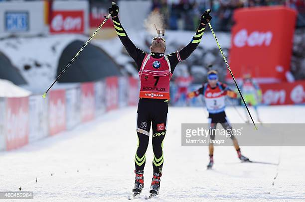 Martin Fourcade of France celebrates at the finish of the men's 12,5 km pursuit event during the IBU Biathlon World Cup on December 14, 2014 in...