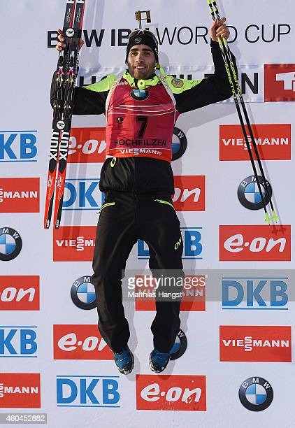 Martin Fourcade of France celebrates at the podium of the men's 12,5 km pursuit event during the IBU Biathlon World Cup on December 14, 2014 in...