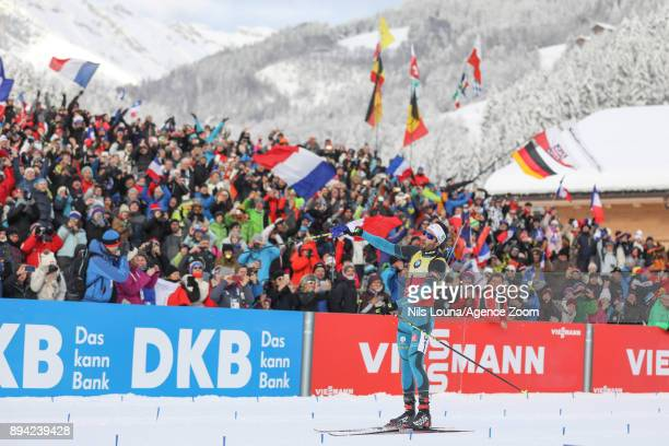 Martin Fourcade of France celebrates during the IBU Biathlon World Cup Men's and Women's Mass Start on December 17 2017 in Le Grand Bornand France