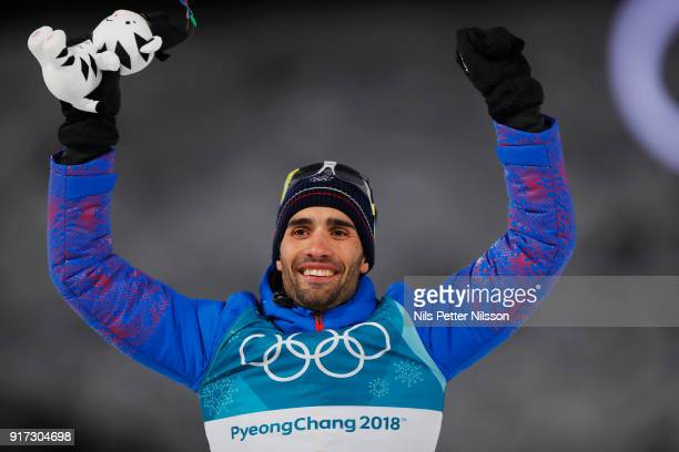 Martin Fourcade of France celebrates his gold during the Mens Biathlon 12.5km Pursuit at Alpensia Biathlon Centre on February 12, 2018 in...