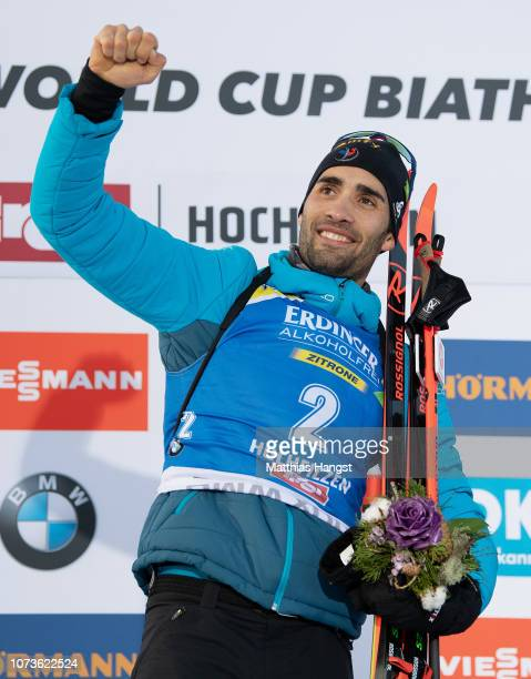 Martin Fourcade of France celebrates his gold medal on the podium during the IBU Biathlon World Cup Men's 125 km Pursuit on December 15 2018 in...