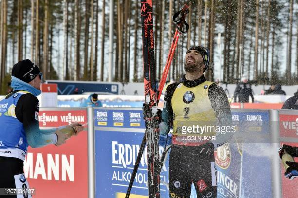 TOPSHOT Martin Fourcade of France celebrates his victory and end of career after the men's 125 km Pursuit competition at the IBU Biathlon World Cup...