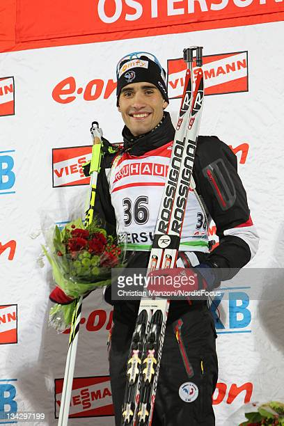 Martin Fourcade of France celebrates his victory in the mens 20km individual during the IBU Biathlon World Cup on November 30 in Oestersund, Sweden.