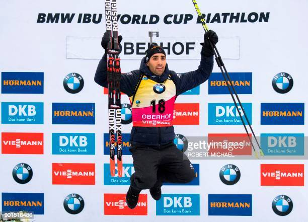 Martin Fourcade of France celebrates on the podium after winning the men's 10 km sprint event of the IBU Biathlon World Cup in Oberhof eastern...