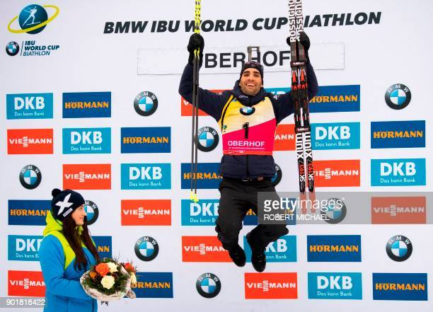 TOPSHOT Martin Fourcade of France celebrates on the podium after winning the men's 125 km pursuit event of the IBU Biathlon World Cup in Oberhof...