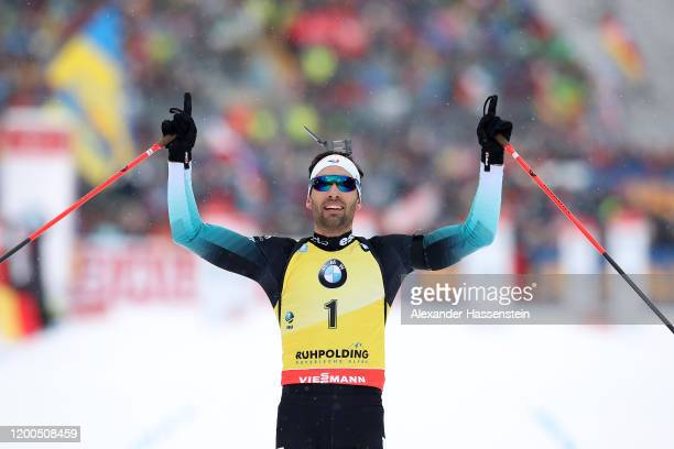 Martin Fourcade of France celebrates victory as he crossed the finish line of the Men 125 km Pursuit Competition at the BMW IBU World Cup Biathlon...