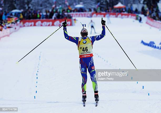 Martin Fourcade of France celebrates victory as he crosses the finish line in the mens 20km Biathlon race at the IBU Biathlon World Cup Ruhpolding on...