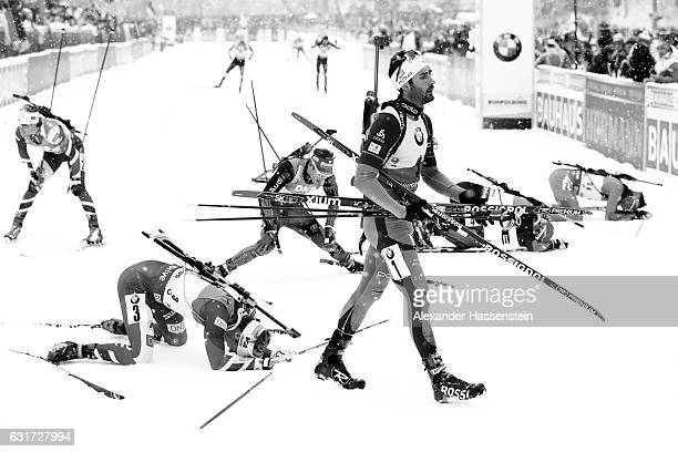 Martin Fourcade of France celebrates winning the 12.5 km Men's Pursuit at the finish area during the IBU Biathlon World Cup at Chiemgau Arena on...