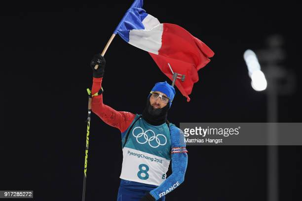 Martin Fourcade of France celebrates winning the gold medal during the Men's Biathlon 125km Pursuit on day three of the PyeongChang 2018 Winter...