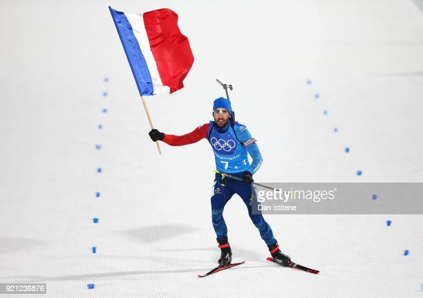 Martin Fourcade of France celebrates winning the gold medal during the Biathlon 2x6km Women 2x75km Men Mixed Relay on day 11 of the PyeongChang 2018...