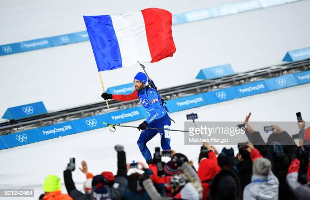 Martin Fourcade of France celebrates winning the gold medal during the Biathlon 2x6km Women + 2x7.5km Men Mixed Relay on day 11 of the PyeongChang...