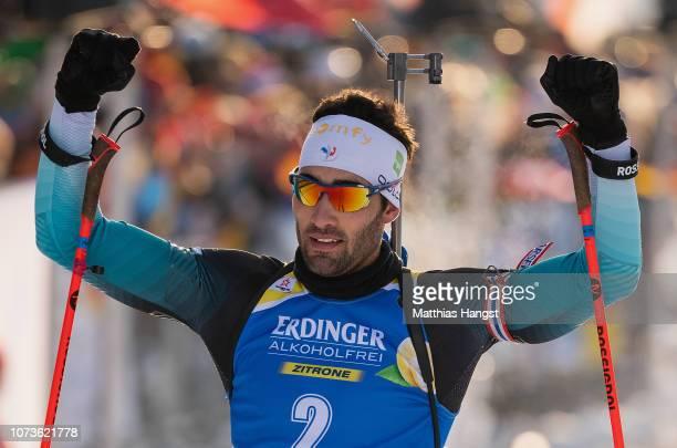 Martin Fourcade of France celebrates winning the IBU Biathlon World Cup Men's 12.5 km Pursuit on December 15, 2018 in Hochfilzen, Austria.