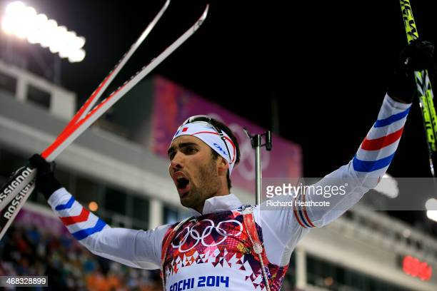 Martin Fourcade of France celebrates winning the Men's 12.5 km Pursuit during day three of the Sochi 2014 Winter Olympics at Laura Cross-country Ski...