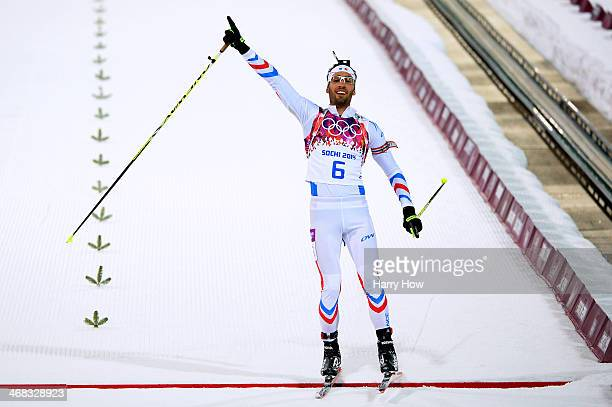 Martin Fourcade of France celebrates winning the Men's 125 km Pursuit during day three of the Sochi 2014 Winter Olympics at Laura Crosscountry Ski...