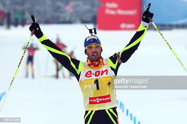 Martin Fourcade of France celebrates winning the men's 15km mass start event during the IBU Biathlon World Cup at Chiemgau Arena on January 13, 2013...