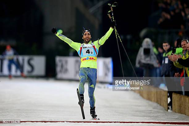 Martin Fourcade of France celebrates winning with Marie DorinHabert of France the IKK classic Biathlon World Team Challenge 2015 at VeltinsArena on...