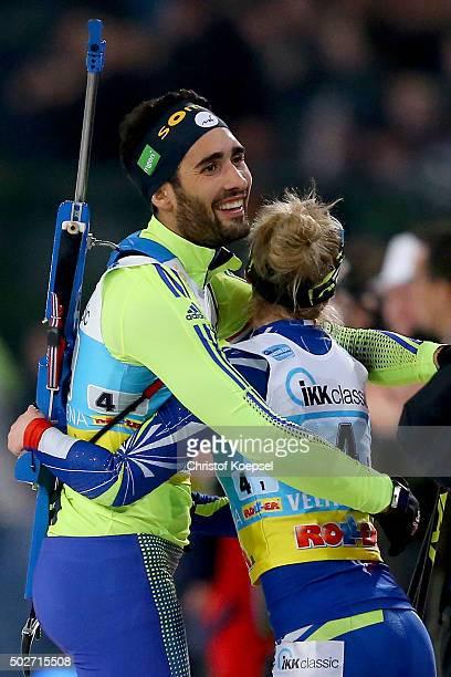 Martin Fourcade of France celebrates winning with Marie Dorin-Habert of France the IKK classic Biathlon World Team Challenge 2015 at Veltins-Arena on...