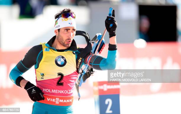 Martin Fourcade of France competes during the IBU Biathlon World Cup Biathlon Men 125 km pursuit competition in Oslo on March 18 2017 / AFP PHOTO /...
