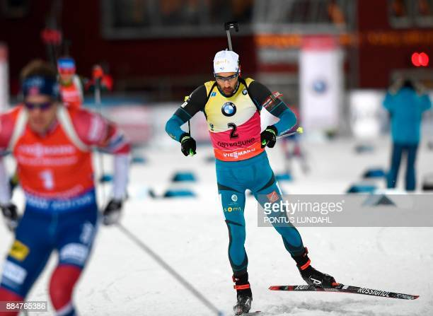 Martin Fourcade of France competes in the men's 125 km pursuit event at the IBU World Cup Biathlon on December 3 2017 in Ostersund Sweden / AFP PHOTO...
