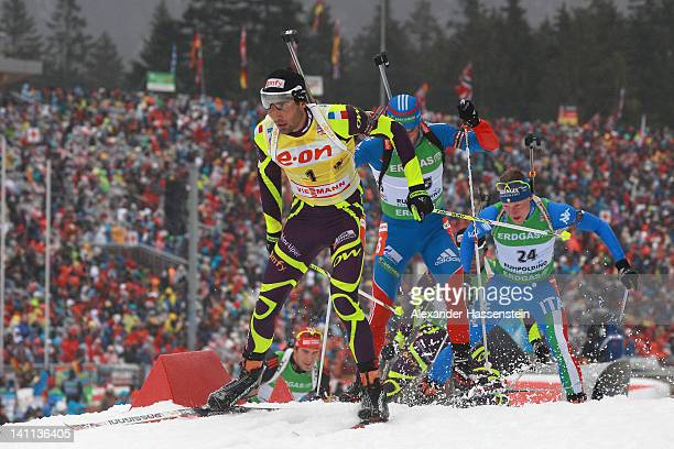 Martin Fourcade of France competes in the Men's 15km Mass Start during the IBU Biathlon World Championships at Chiemgau Arena on March 11, 2012 in...