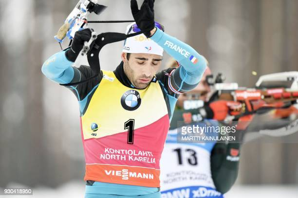 Martin Fourcade of France competes in the men's 15km mass start event at the IBU Biathlon World Cup in Kontiolahti Finland on March 11 2018 / AFP...