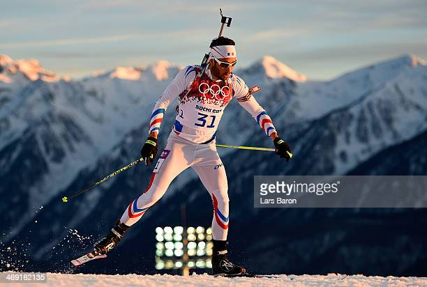Martin Fourcade of France competes in the Men's Individual 20 km during day six of the Sochi 2014 Winter Olympics at Laura Crosscountry Ski Biathlon...