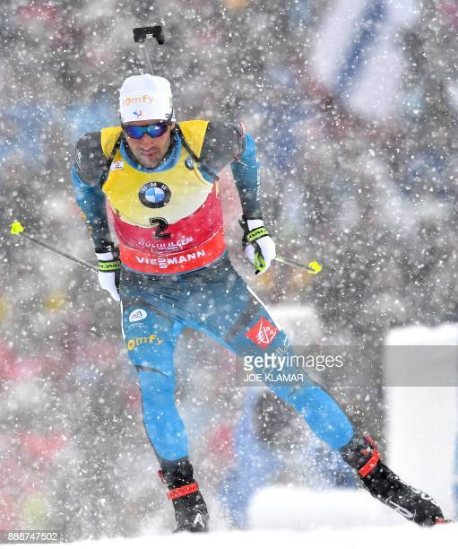 Martin Fourcade of France competes to place third in the men's 125 km pursuit event at the IBU World Cup Biathlon in Hochfilzen Austria on December 9...