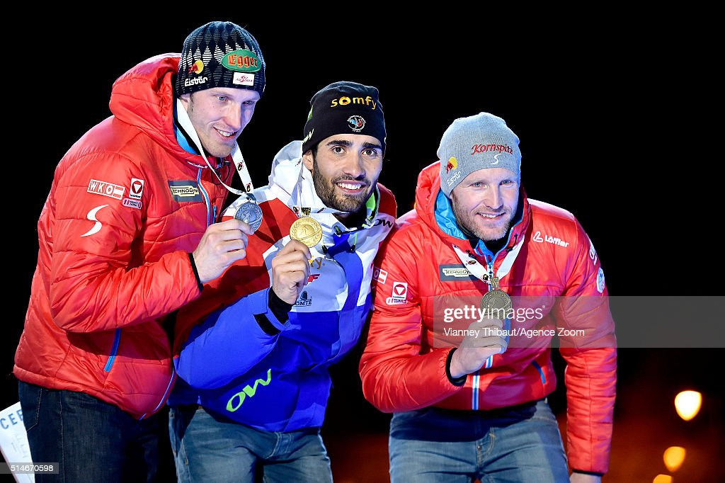 Martin Fourcade (C) of France, Dominik Landertinger of Austria and Simon Eder of Austria pose with their medals after the IBU Biathlon World Championships Men's 20km Individual on March 10, 2016 in Oslo, Norway.