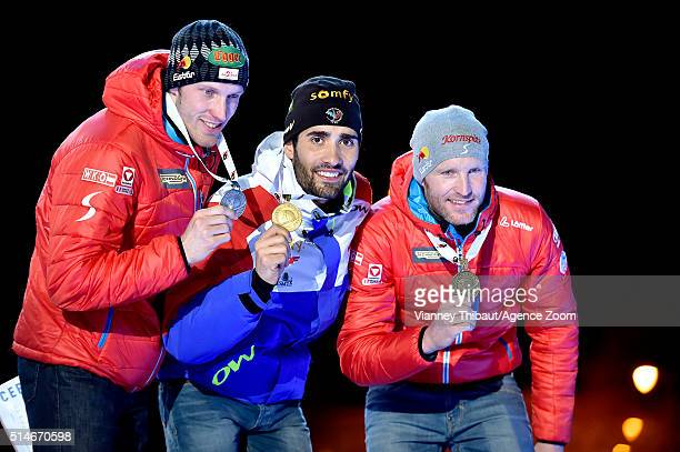 Martin Fourcade of France Dominik Landertinger of Austria and Simon Eder of Austria pose with their medals after the IBU Biathlon World Championships...