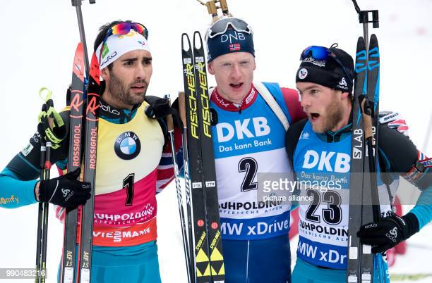 Martin Fourcade of France Johannes Thingnes Boe of Norway and Antonin Guigonnat of France  at the finish line after the men's mass start event of the...