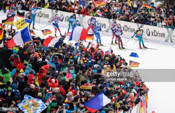 Martin Fourcade of France leads the field beside Anton Schipulin of Russia during the men's mass start event of the Biathlon World Cup at the...