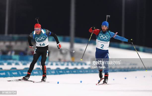 Martin Fourcade of France narrowly wins the gold medal from silver medallist Simon Schempp of Germany during the Men's 15km Mass Start Biathlon on...