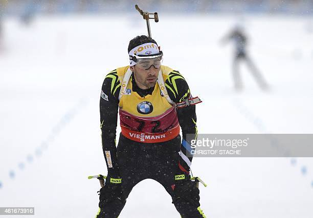 Martin Fourcade of France reacts after crossing the finish line of the men's 10 kilometers sprint competition at the Biathlon World Cup on January...