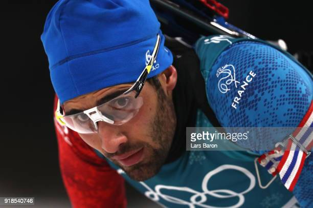 Martin Fourcade of France reacts at the finish during the Men's 20km Individual Biathlon at Alpensia Biathlon Centre on February 15 2018 in...