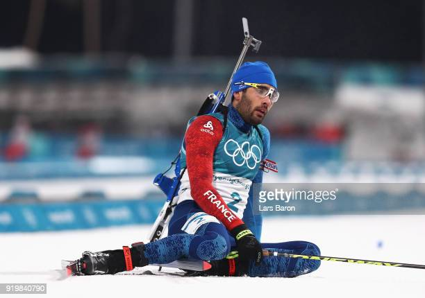 Martin Fourcade of France sits in the snow after winning the gold medal during the Men's 15km Mass Start Biathlon on day nine of the PyeongChang 2018...
