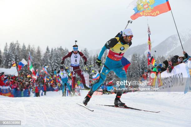 Martin Fourcade of France takes 1st place Anton Shipulin of Russia competes during the IBU Biathlon World Cup Men's and Women's Mass Start on January...