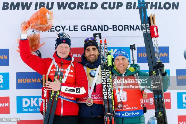 Martin Fourcade of France takes 1st place Johannes Thingnes Boe of Norway takes 2nd place Erik Lesser of Germany takes 3rd place during the IBU...