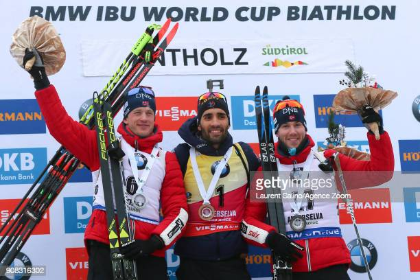 Martin Fourcade of France takes 1st place Tarjei Boe of Norway takes 2nd place Erlend Bjoentegaard of Norway takes 3rd place during the IBU Biathlon...