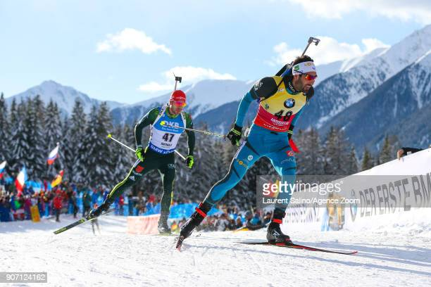 Martin Fourcade of France takes 2nd place Arnd Peiffer of Germany takes 3rd place during the IBU Biathlon World Cup Men's Sprint on January 19 2018...