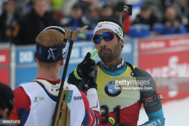 Martin Fourcade of France takes 2nd place Johannes Thingnes Boe of Norway takes 1st place during the IBU Biathlon World Cup Men's Sprint on December...