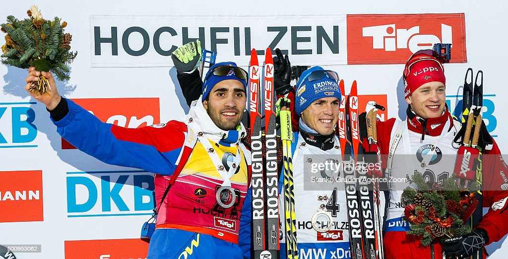 Martin Fourcade of France takes 2nd place, Simon Schempp of Germany takes 1st place, Tarjei Boe of Norway takes 1st place during the IBU Biathlon World Cup Men's and Women's Sprint on December 11, 2015 in Hochfilzen, Austria.