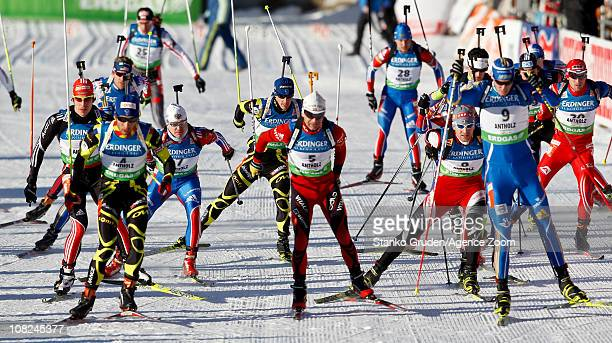 Martin Fourcade of France wins 1st place during the IBU World Cup Biathlon Men's 15 km Mass Start on January 22, 2011 in Antholz-Anterselva, Italy.