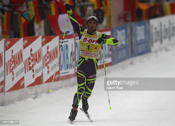 Martin Fourcade of Frnace celebrates after winning the gold medal in the Men's 15km Mass Start during the IBU Biathlon World Championships at...