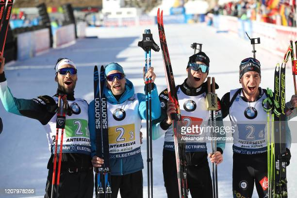 Martin Fourcade Simon Desthieux Emilien Jacquelin and Quentin Fillon Maillet celebrate winning the 1st place after the Men 4x75 km Relay Competition...