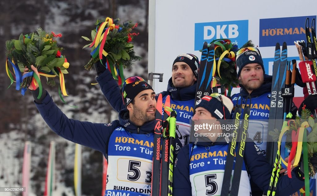 Martin Fourcade, Simon Desthieux, Quentin Fillon Maillet and Antonin Guigonnat of France celebrate placing 2nd on the podium after the men's 4 x 7,5km relay event at the Biathlon World Cup on January 12, 2018 in Ruhpolding, southern Germany. Norway won the evend ahead of France (2nd) and Russia (3rd). /
